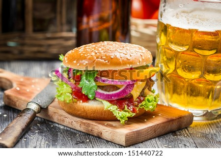 Fresh homemade burger and a cold beer - stock photo
