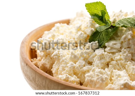 fresh homemade cheese in a bowl on a white background - stock photo