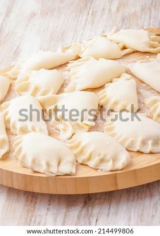 Fresh homemade dumplings ready to cooking - stock photo