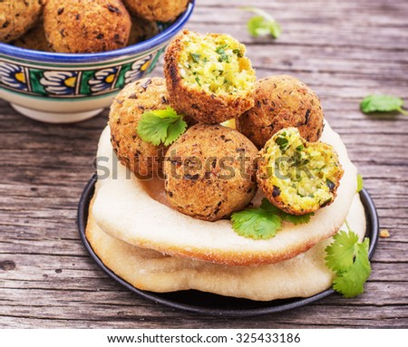 Fresh homemade falafel chickpea on wooden background freshly baked cakes pita. selective Focus - stock photo