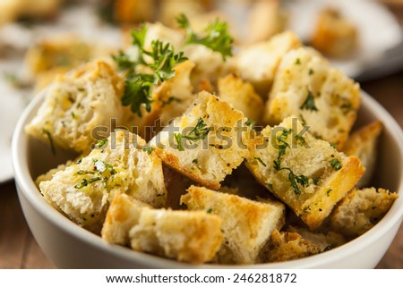 Fresh Homemade French Croutons with Seasoning and Parsley - stock photo