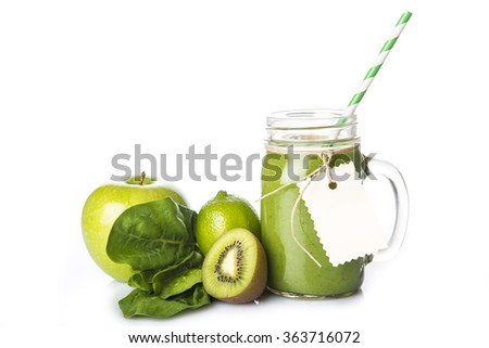 Fresh homemade green smoothie and ingredients isolated on a white background - stock photo