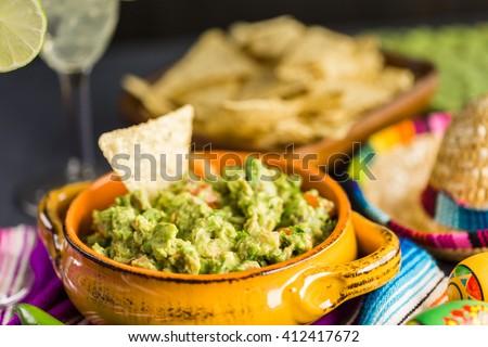 Fresh homemade guacamole in the bowl. - stock photo