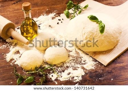 fresh homemade pizza dough - stock photo