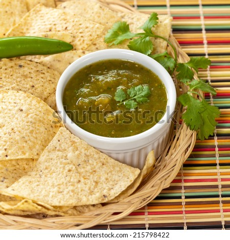 Fresh Homemade Salsa Verde with tortilla chips - stock photo
