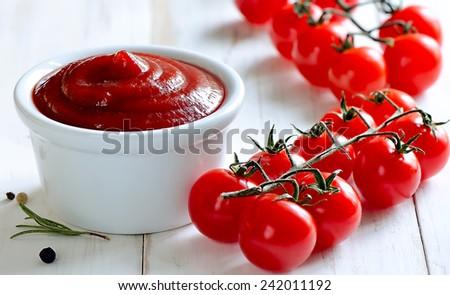 Fresh homemade tomato sauce in a white bowl - stock photo