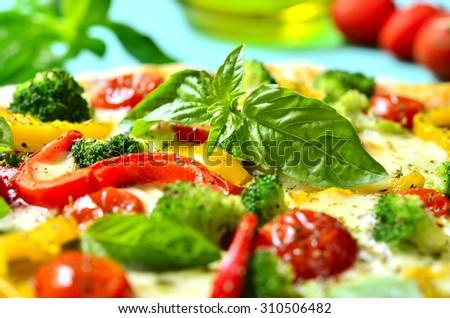 Fresh homemade veggie pizza on a table. - stock photo
