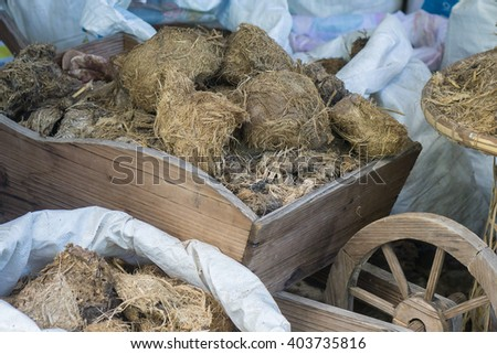 fresh horse manure on cart,Dried horse poo texture,elephant poo,selective focus - stock photo