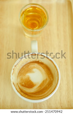 Fresh hot coffee cup and tea glass set on wood tray  - stock photo