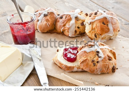 Fresh hot cross buns with butter and jam for easter - stock photo