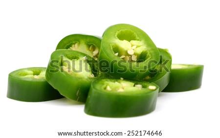 fresh hot green pepper sliced on white background - stock photo
