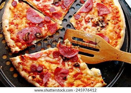 Fresh hot homemade sliced pepperoni pizza - stock photo