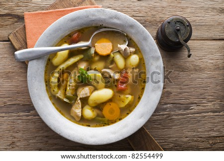 Fresh hot homemade stew with chicken, potatoes and vegetables - stock photo