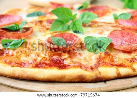 Fresh hot pepperoni pizza - closeup - stock photo