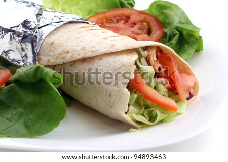 Fresh hot tortilla with vegetables - stock photo