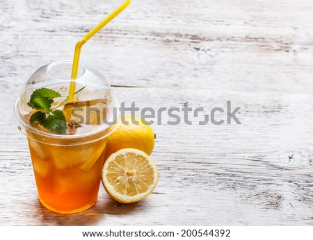 Fresh ice tea in plastic cup - stock photo