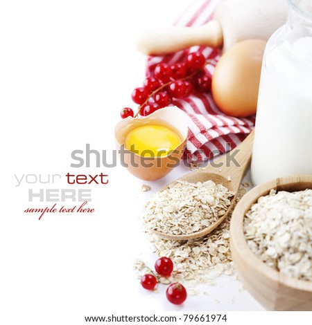 Fresh ingredients for oatmeal cookies (oat flakes, eggs, milk, fresh ripe currant) over white with sample text - stock photo