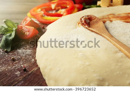 Fresh ingredients for pizza preparing on wooden table, close up - stock photo