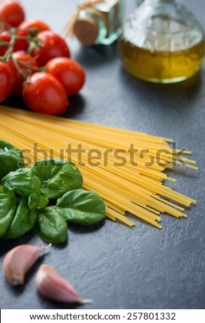 Fresh ingredients to make pasta with tomato sauce on blackboard - stock photo