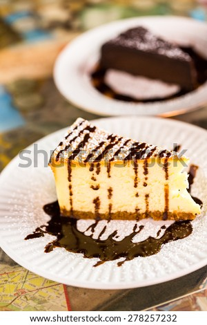 Fresh Italian Bailey's cheesecake with coffee on the table.