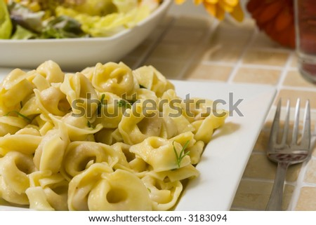 fresh italian pasta tortellini with garlic and parsley