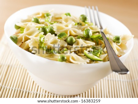 fresh italian pasta with peas and pumpkin - stock photo