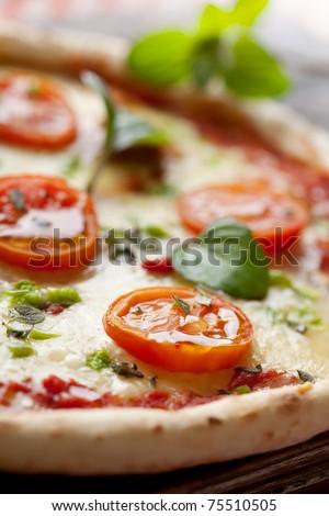 fresh italian pizza, with tomato, mozzarella and green pepper - stock photo