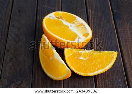 Fresh jucy orange in half and slices - stock photo