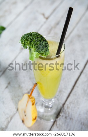 fresh juice from fruits and vegetables in a glass. Photo on a white background