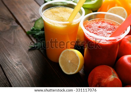 Fresh juice mix fruit, healthy drinks on wooden background - stock photo