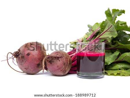 Fresh juice of red beets on white - stock photo