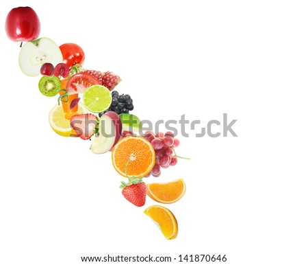 fresh juice pours from fruits on a white background - stock photo