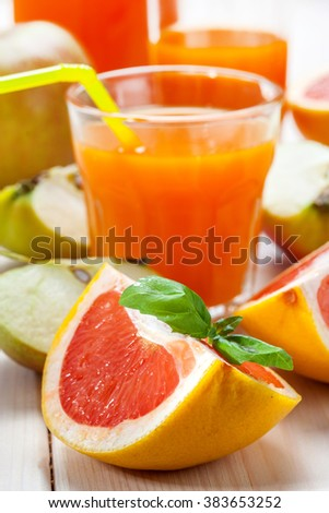 Fresh juice with apples and red grapefruit. Selective focus.