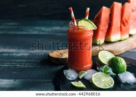 Fresh juice with watermelon and lime juice in the jar,selective focus
