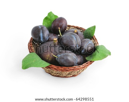 Fresh juicy fruits, plums and figs, with green leaves in a basket isolated on white background - stock photo