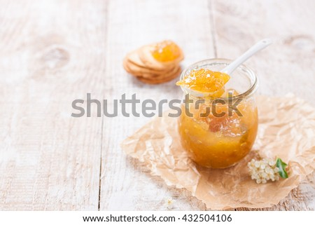 Fresh juicy fruity jam with figs in a jar with crackers and cottage cheese for breakfast, horizontal, with copy space - stock photo