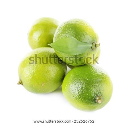 Fresh juicy limes isolated on white - stock photo