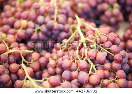 Fresh, juicy, ripe red grapes at the farmers market - stock photo