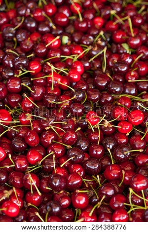 Fresh juicy sweet dark red cherries ready for sale on the marketplace - stock photo