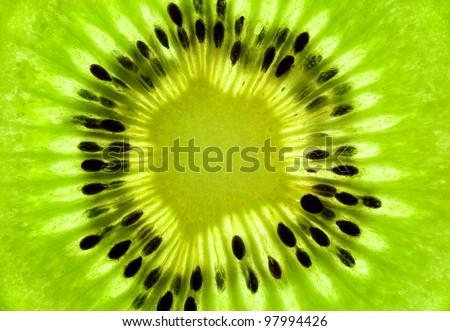 Fresh Kiwi background / SuperMacro / back lit - stock photo