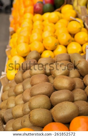 Fresh kiwi fruit at marketplace ready for sale. Shallow depth of field. - stock photo