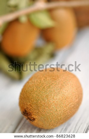 Fresh kiwi on a wooden table