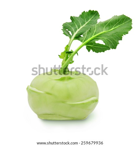 Fresh kohlrabi with green leaves on isolated white backround - stock photo