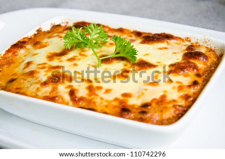 fresh lasagna dish in a baking dish - stock photo