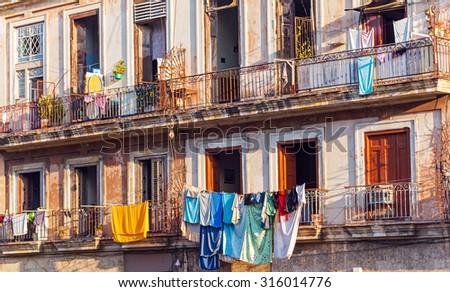 Fresh laundry on the balcony of old home, Havana, Cuba - stock photo