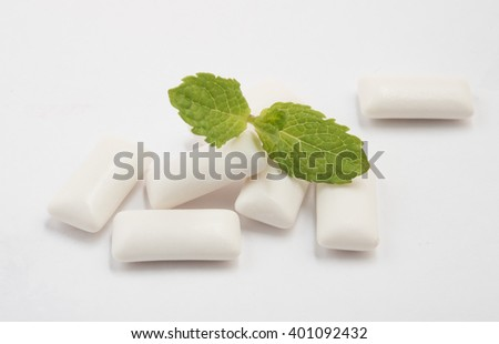 Fresh leas mint with six chewing gum isolated on white background - stock photo