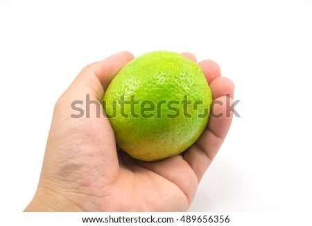Fresh lemon in hands isolated on white background.