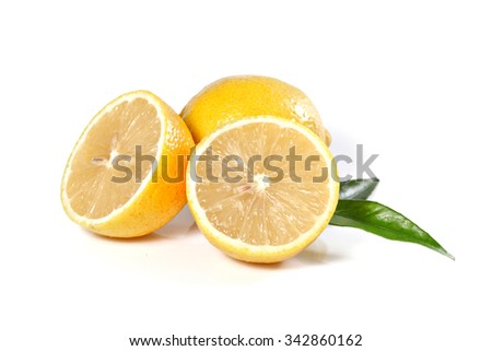 Fresh lemon, isolated on white, shallow focus - stock photo
