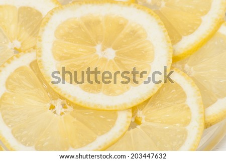 Fresh Lemon Slices On A Plate.