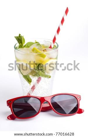 Fresh lemonade and sunglasses - stock photo